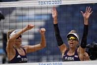 April Ross, right of the United States, and teammate Alix Klineman, left, wave to the stands after they won a women's beach volleyball match against Cuba at the 2020 Summer Olympics, Monday, Aug. 2, 2021, in Tokyo, Japan. (AP Photo/Petros Giannakouris)