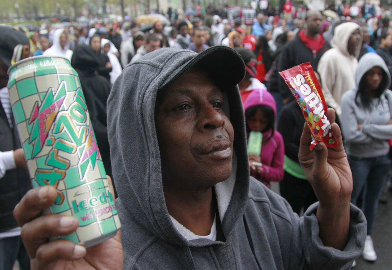 Kenneth Taylor holds a can of tea and a bag of Skittles at a rally demanding justice for Trayvon Martin in Freedom Plaza, Saturday, March 24, 2012, in Washington. Martin, an unarmed young black teen was fatally shot by a volunteer neighborhood watchman. (AP Photo/Haraz N. Ghanbari)