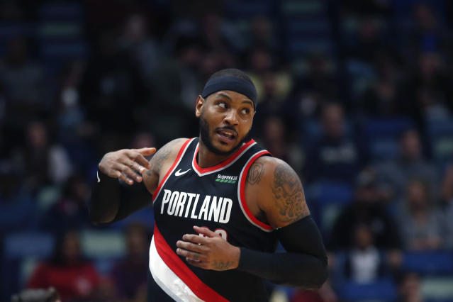Portland Trail Blazers forward Carmelo Anthony turns down court after making a 3-point basket in the first half of an NBA basketball game against the New Orleans Pelicans in New Orleans, Tuesday, Nov. 19, 2019. (AP Photo/Gerald Herbert)
