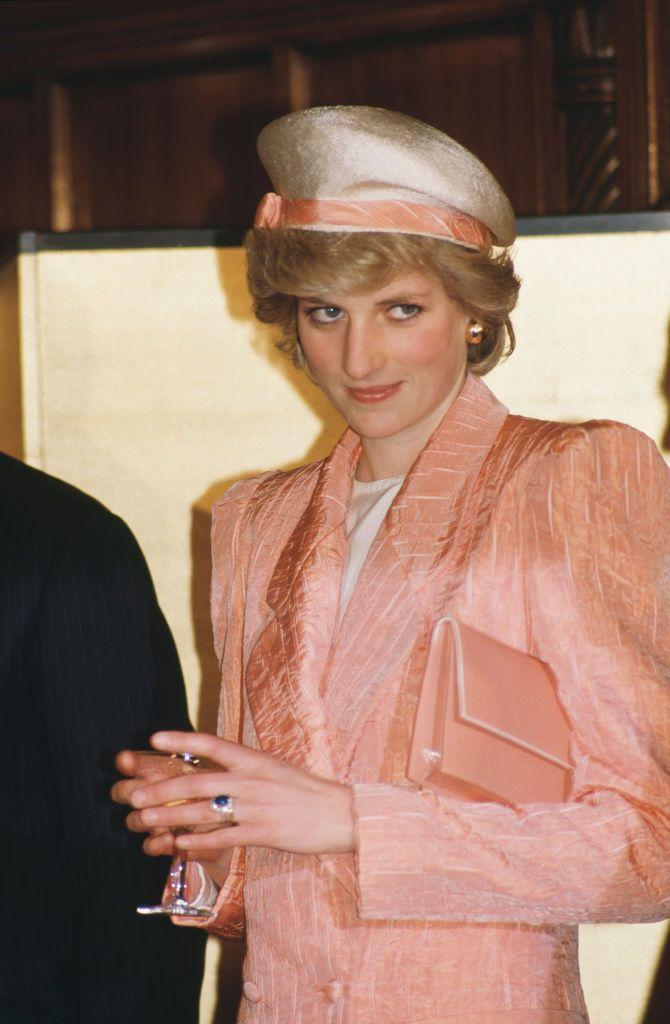 <p>Diana wore a peach blazer with a perfectly coordinated hat and bag during a visit to Tokyo parliament in May 1986. It was simply monochromatic styling at its finest.<br></p>