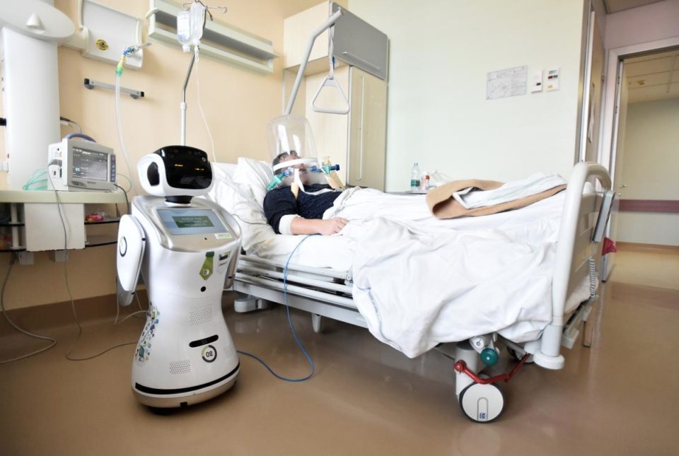 A medical robot in Italy helps tend to a patient afflicted by the novel coronavirus.