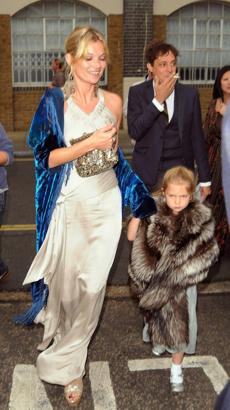 <p>When Leah Wood and Jack Macdonald got wed, Kate Moss made sure she was looking her best in a silk gown and velvet wrap.</p>