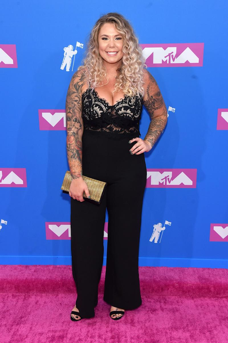 Kailyn Lowry looks amazing in this black jumpsuit with black heel sandals to match.