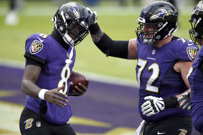 Baltimore Ravens quarterback Lamar Jackson (8) is congratulated by guard Ben Powers (72) after scoring a touchdown on a run against the Jacksonville Jaguars during the second half of an NFL football game, Sunday, Dec. 20, 2020, in Baltimore. (AP Photo/Gail Burton)
