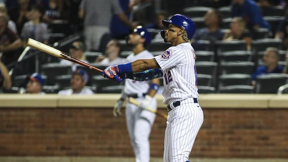 Sep 12, 2021; New York City, New York, USA; New York Mets shortstop Francisco Lindor (12) watches after hitting a three run home run in the second inning against the New York Yankees at Citi Field.