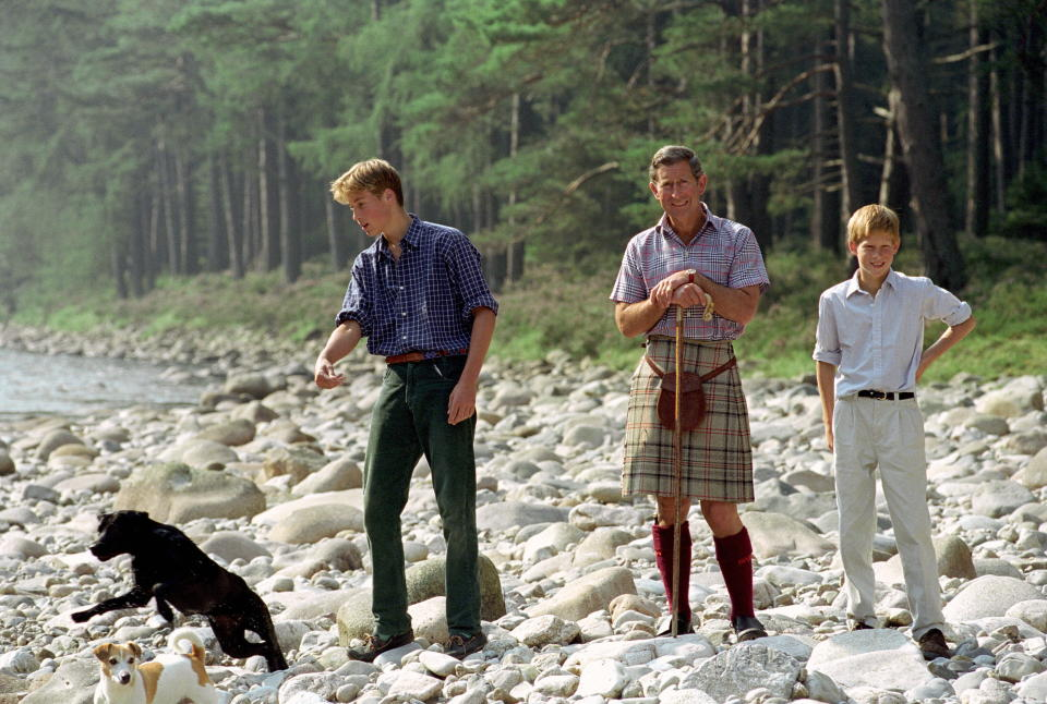 BALMORAL, UNITED KINGDOM - AUGUST 10: Prince Charles In Kilt And Sporran And Shepherd's Crook Walking Stick With Prince William & Prince Harry At Polvier, By The River Dee, Balmoral Castle Estate. Prince William's Dog Widgeon (black Labrador) And Prince Charles's Jack Russell Dog Called Tigga (tigger) Are With Them (Photo by Tim Graham Photo Library via Getty Images)