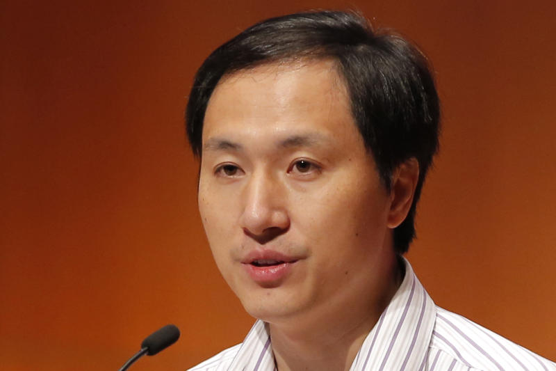 FILE - In this Nov. 28, 2018, file photo, He Jiankui, a Chinese researcher, speaks during the Human Genome Editing Conference in Hong Kong, where he made his first public comments about his claim to have helped make the world's first gene-edited babies. Chinese state media says the researcher He has been sentenced to three years for practicing medicine illegally. He Jiankui was also fined 3 million yuan. Two others were also sentenced on the same charge. (AP Photo/Kin Cheung, File)
