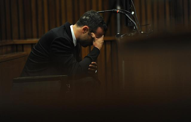 Oscar Pistorius, puts his hands to his head while listening to evidence from a witness speaking about the morning of the shooting of his girlfriend Reeva Steenkamp, on the fourth day of his trial at the high court in Pretoria, South Africa, Thursday, March 6, 2014. Pistorius is charged with murder for the shooting death of his girlfriend, Steenkamp, on Valentines Day in 2013. (AP Photo/Werner Beukes, Pool)