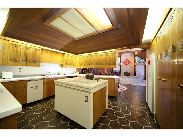 "<p>The upgraded kitchen is finished with corian. (Listing via <a href=""https://www.point2homes.com/CA/Home-For-Sale/AB/Calgary/Pump-Hill/15-PUMP-HILL-CL-SW/37432026.html"" rel=""nofollow noopener"" target=""_blank"" data-ylk=""slk:Point2Homes"" class=""link rapid-noclick-resp"">Point2Homes</a>) </p>"