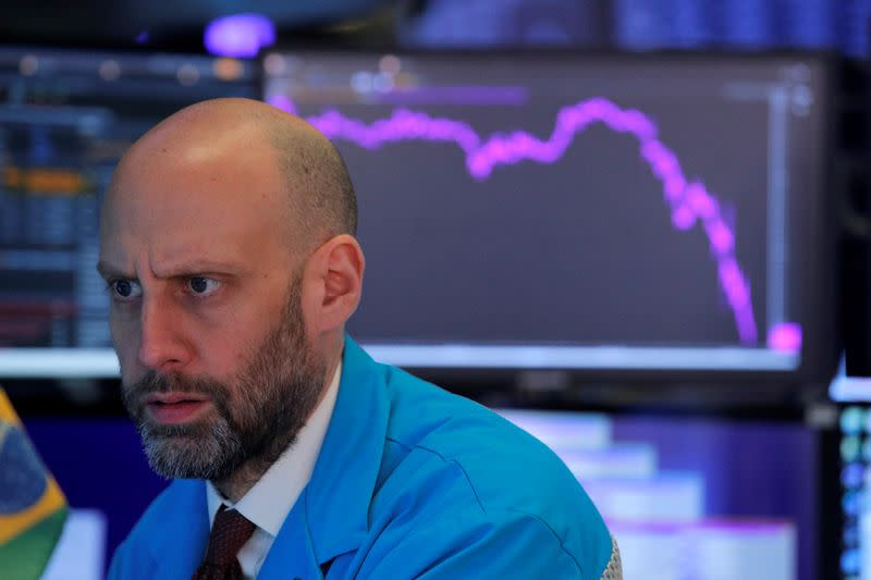 Trading on Wall Street temporarily suspended after Trump's crisis response disappoints