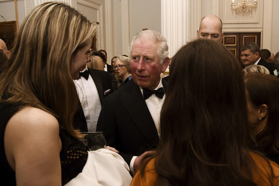 FILE - In this March 12, 2020 file photo, Britain's Prince Charles, centre, meets guests at a dinner at Mansion House in London. Prince Charles, the heir to the British throne, has tested positive for the new coronavirus. The prince's Clarence House office reported on Wednesday, March 25, 2020 that the 71-year-old is showing mild symptoms of COVID-19 and is self-isolating at a royal estate in Scotland. It says his wife Camilla has tested negative. (Eamonn McCormack/PA via AP, File)