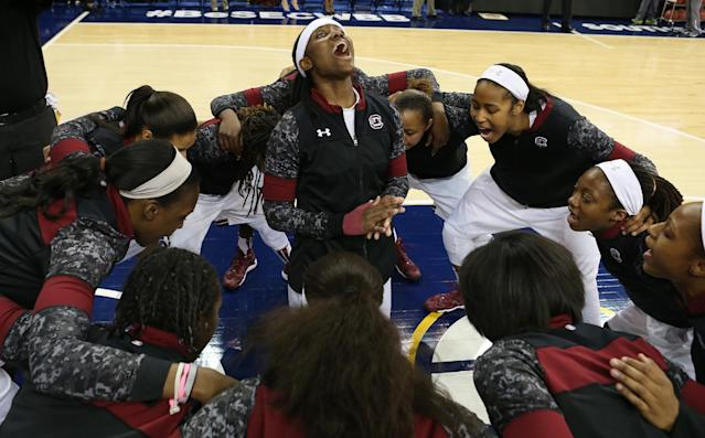 South Carolina guard Khadijah Sessions, center, leads her team during a pregame huddle before the start of an NCAA college basketball game against Kentucky in the semifinals of the Southeastern Conference women's basketball tournament Saturday, March 8, 2014, in Duluth, Ga. (AP Photo/Jason Getz)