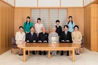 FILE PHOTO: Japanese Emperor Akihito and Empress Michiko with their family members during a family photo session for the New Year at the Imperial Palace in Tokyo
