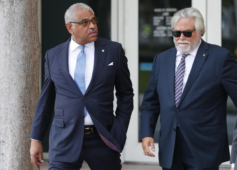 Carnival Corp. CEO Arnold Donald, left, and chairman Micky Arison walk to federal court, Wednesday, Oct. 2, 2019, in Miami. Top Carnival Corp. executives are back in court to explain what the world's largest cruise line is doing to reduce ocean pollution. (AP Photo/Wilfredo Lee)