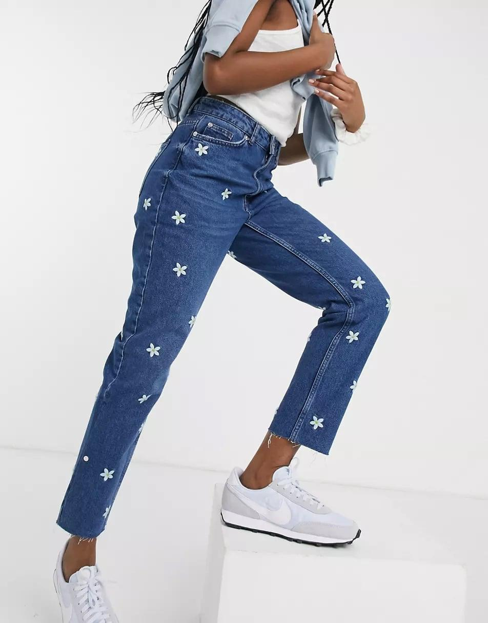 <p><span>New Look Daisy Embroidered Mom Jeans</span> ($55)</p>