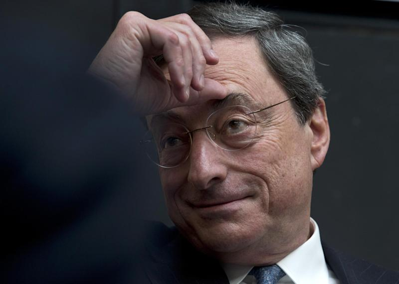 """European Central Bank President Mario Draghi listens to questions of students during a session of """"Room for Discussion"""" at the Faculty of Economics of the UvA, or University of Amsterdam, Netherlands, Monday April 15, 2013. (AP Photo/Peter Dejong)"""
