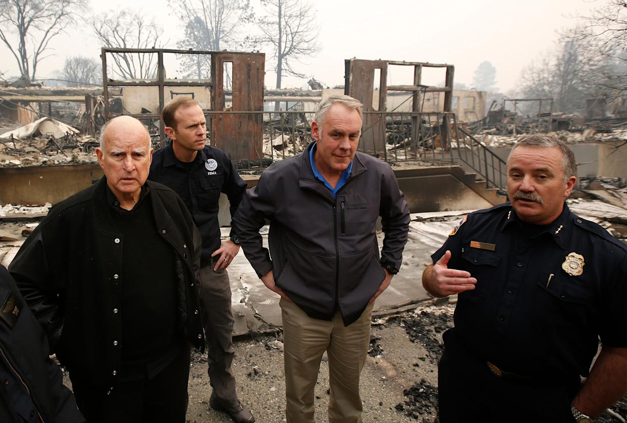 (From left) California Gov. Jerry Brown, Federal Emergency Management Agency Director Brock Long,Interior Secretary Ryan Zinke and Cal Fire'sScott Upton at the fire-ravaged Paradise Elementary School, Nov. 14, in Paradise, California. (Photo: ASSOCIATED PRESS)