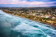 """<p>Once named among the <a href=""""https://www.sandiegouniontribune.com/sdut-encinitas-named-one-worlds-best-surf-towns-2012jul26-story.html#:~:text=Encinitas%20was%20named%20one%20of,Beach%2C%20NC%2C%20among%20others."""" class=""""link rapid-noclick-resp"""" rel=""""nofollow noopener"""" target=""""_blank"""" data-ylk=""""slk:20 best surf towns"""">20 best surf towns</a> in the world by <strong>National Geographic</strong>, Encinitas wears its surf history proudly. Located along six miles of Pacific Ocean coastline, Encinitas is a reminder of the historic Highway 101 beach culture that thrived in the mid-1900s. While the city's eclectic downtown has long drawn surfers and hippies with its unique and dynamic blend of San Diego's top surf shops, coffee houses, and record stores, with new restaurants, eclectic shops, and the <a href=""""http://www.alilahotels.com/marea-beach-resort-encinitas"""" class=""""link rapid-noclick-resp"""" rel=""""nofollow noopener"""" target=""""_blank"""" data-ylk=""""slk:Alila Marea Beach Resort Encinitas"""">Alila Marea Beach Resort Encinitas</a> popping up, the town has solidified itself as a national sought-after destination in Southern California.</p>"""