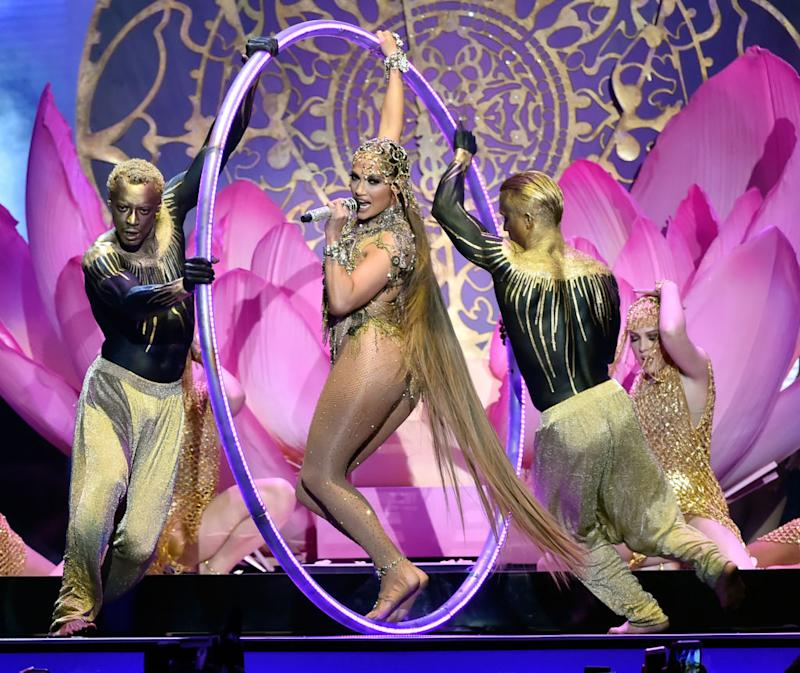 Jennifer Lopez performed at the Billboard Latin Music Awards with floor-length hair and things got pretty tangled. (Photo: Getty Images)