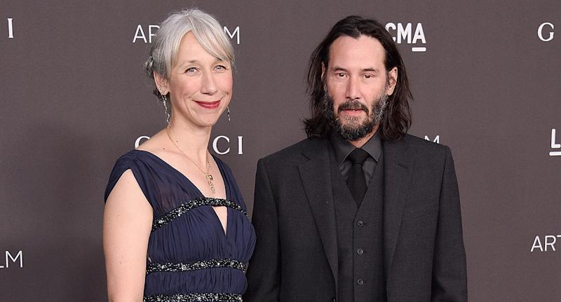 Alexandra Grant pictured with Keanu Reeves on the red carpet. [Photo: Getty]