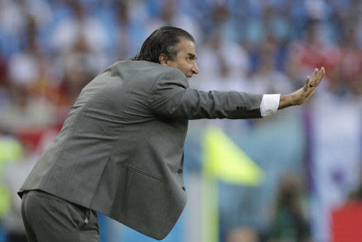 Saudi Arabia head coach Juan Antonio Pizzi instructs players during the group A match between Uruguay and Saudi Arabia at the 2018 soccer World Cup in Rostov Arena in Rostov-on-Don, Russia, Wednesday, June 20, 2018. (AP Photo/Andrew Medichini)
