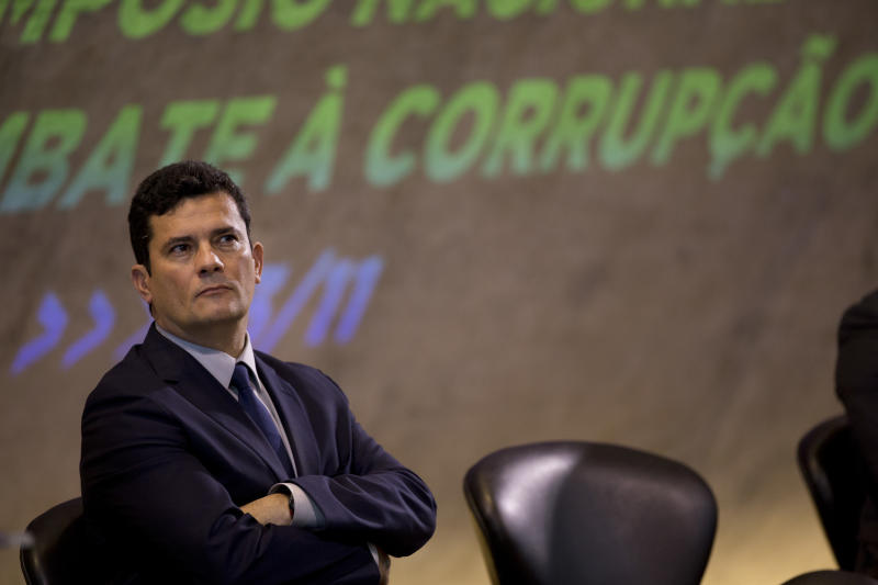Former Judge Sergio Moro participates in an anti-corruption conference in Rio de Janeiro, Brazil, Friday, Nov. 23, 2018. Moro said he would present a bill to fight corruption and organized crime in February and reiterated that he had been given carte blanche by the President-elect to carry investigations. (AP Photo/Silvia Izquierdo)