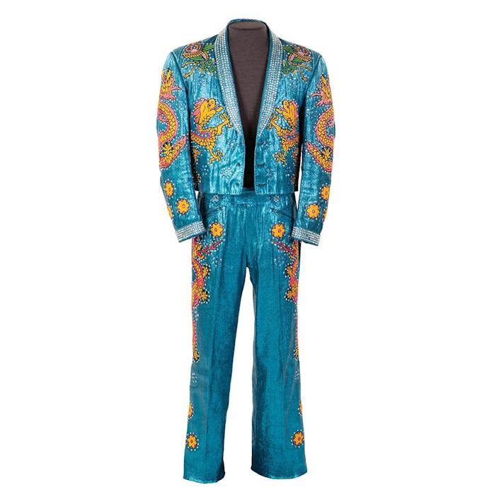 Nudie's Rodeo Tailors made this blue stage costume embellished with rhinestones and embroidered with Chinese New Year motifs for country music singer Hank Snow.