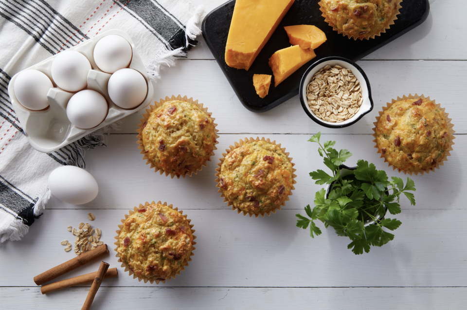 """<p>This muffin recipe is full of <a href=""""https://www.thedailymeal.com/eat/iconic-american-breakfast-dishes?referrer=yahoo&category=beauty_food&include_utm=1&utm_medium=referral&utm_source=yahoo&utm_campaign=feed"""" rel=""""nofollow noopener"""" target=""""_blank"""" data-ylk=""""slk:traditional breakfast flavors"""" class=""""link rapid-noclick-resp"""">traditional breakfast flavors</a> with bacon, quick-cooking oats and of course some eggs. You can always make muffins ahead of time and keep them on the counter. Have some softened butter on hand as you nibble on them here and there. </p> <p><a href=""""https://www.thedailymeal.com/best-recipes/bacon-cheddar-breakfast-muffins?referrer=yahoo&category=beauty_food&include_utm=1&utm_medium=referral&utm_source=yahoo&utm_campaign=feed"""" rel=""""nofollow noopener"""" target=""""_blank"""" data-ylk=""""slk:For the Bacon and Cheddar Breakfast Muffins recipe, click here."""" class=""""link rapid-noclick-resp"""">For the Bacon and Cheddar Breakfast Muffins recipe, click here. </a></p>"""