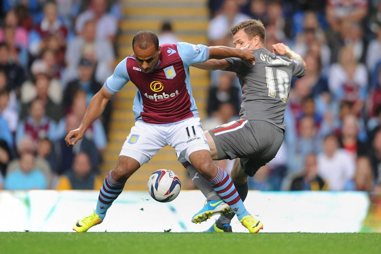 Aston Villa's Gabriel Agbonlahor (left) and Rotherham United's Michael O'Connor (right) during the Capital One Cup, Second Round match at Villa Park, Birmingham.
