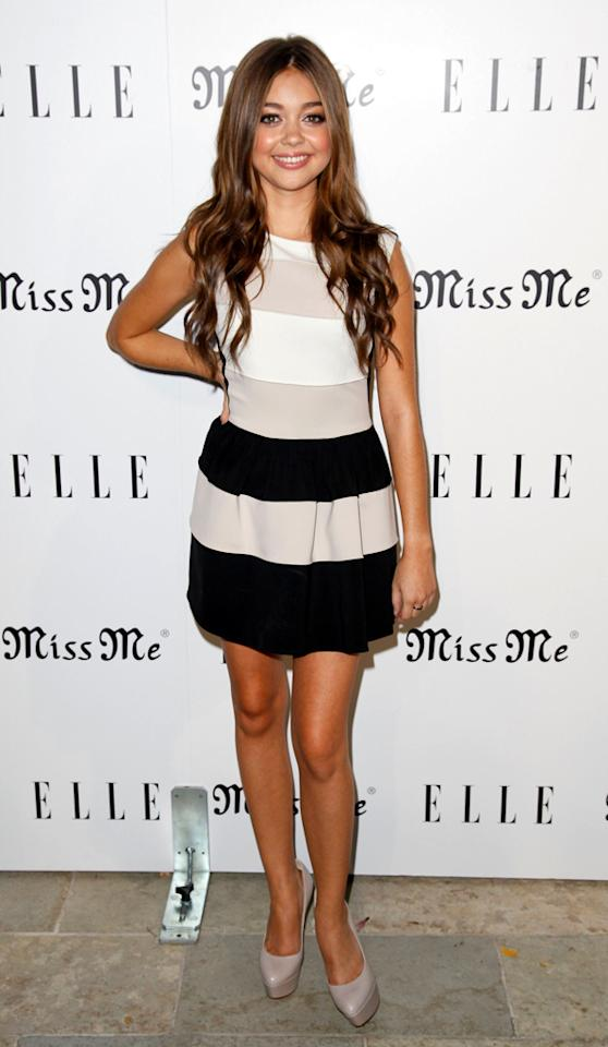 "Actress Sarah Hyland went from ""Modern Family"" to mod in this fun, striped frock. The 21-year-old donned the dress when she hosted the songbirds' <em>Miss Me</em> album release party along with <em>Elle</em> magazine at L.A.'s Sunset Marquis on Thursday. (8/9/2012)"