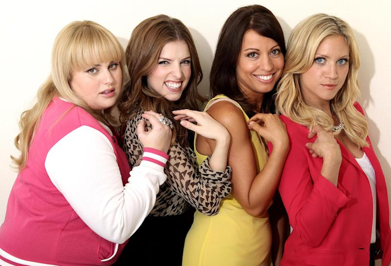 """In this image taken on Fri., Sept. 21, 2012, from left, actress Rebel Wilson, actress Anna Kendrick, screenwriter Kay Cannon, and actress Brittany Snow, from the film """"Pitch Perfect,"""" pose for a portrait at The London Hotel, in West Hollywood, Calif. The musical comedy, which counts Elizabeth Banks among its producers, focuses on the competitive world of college a cappella. Full of music and laughs, the story centers on the Bellas, an all-female group of singing misfits. (Photo by Matt Sayles/Invision/AP)"""