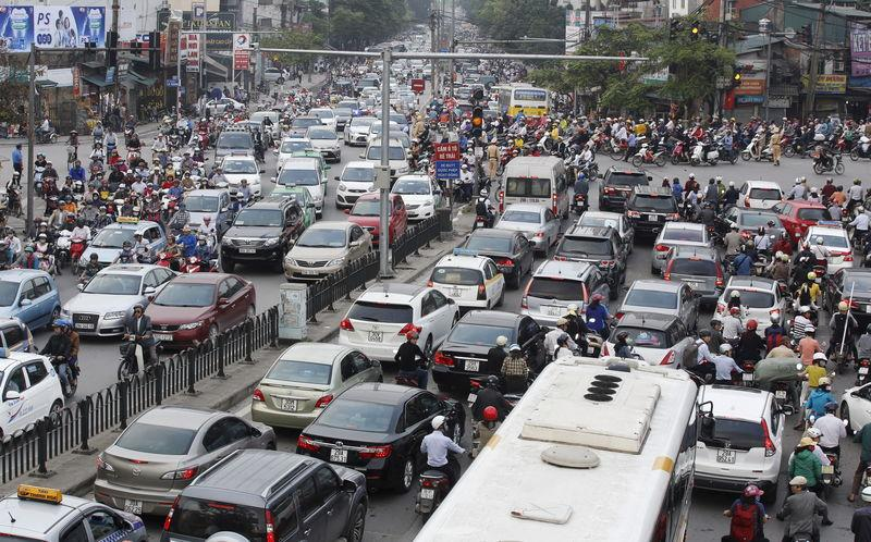 Vehicles are seen along a street in Hanoi