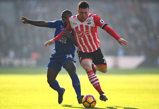 <p>Pierre-Emile Hojbjerg steams past Leicester's Nampalys Mendy </p>