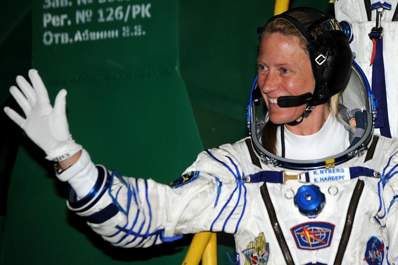 U.S. astronaut Karen Nyberg, crew member of the mission to the International Space Station (ISS), waves prior to the launch of Soyuz-FG rocket at the Russian leased Baikonur Cosmodrome, Kazakhstan, Wednesday, May 29, 2013. (AP Photo/ Kiril Kudryavtsev, Pool)