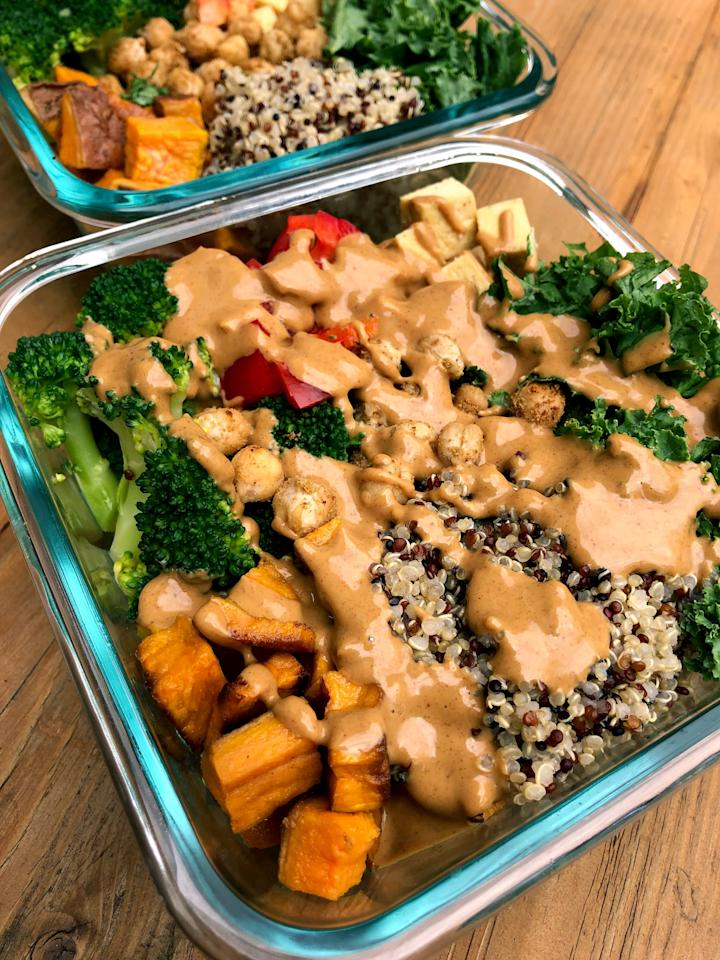 """<p>Your taste buds will delight in roasted sweet potatoes, baked tofu, sautéed spiced chickpeas, steamed broccoli, red peppers, kale, and quinoa. Topped with an easy-to-make creamy peanut sauce; dinner is going to be so awesome!</p> <p><strong>Calories:</strong> 527<br /> <strong>Protein:</strong> 29.3 grams</p> <p><strong>Get the recipe:</strong> <a href=""""https://www.popsugar.com/fitness/Buddha-Bowl-Meal-Prep-45452092"""" >sweet potato, chickpea, and broccoli Buddha bowl</a></p>"""
