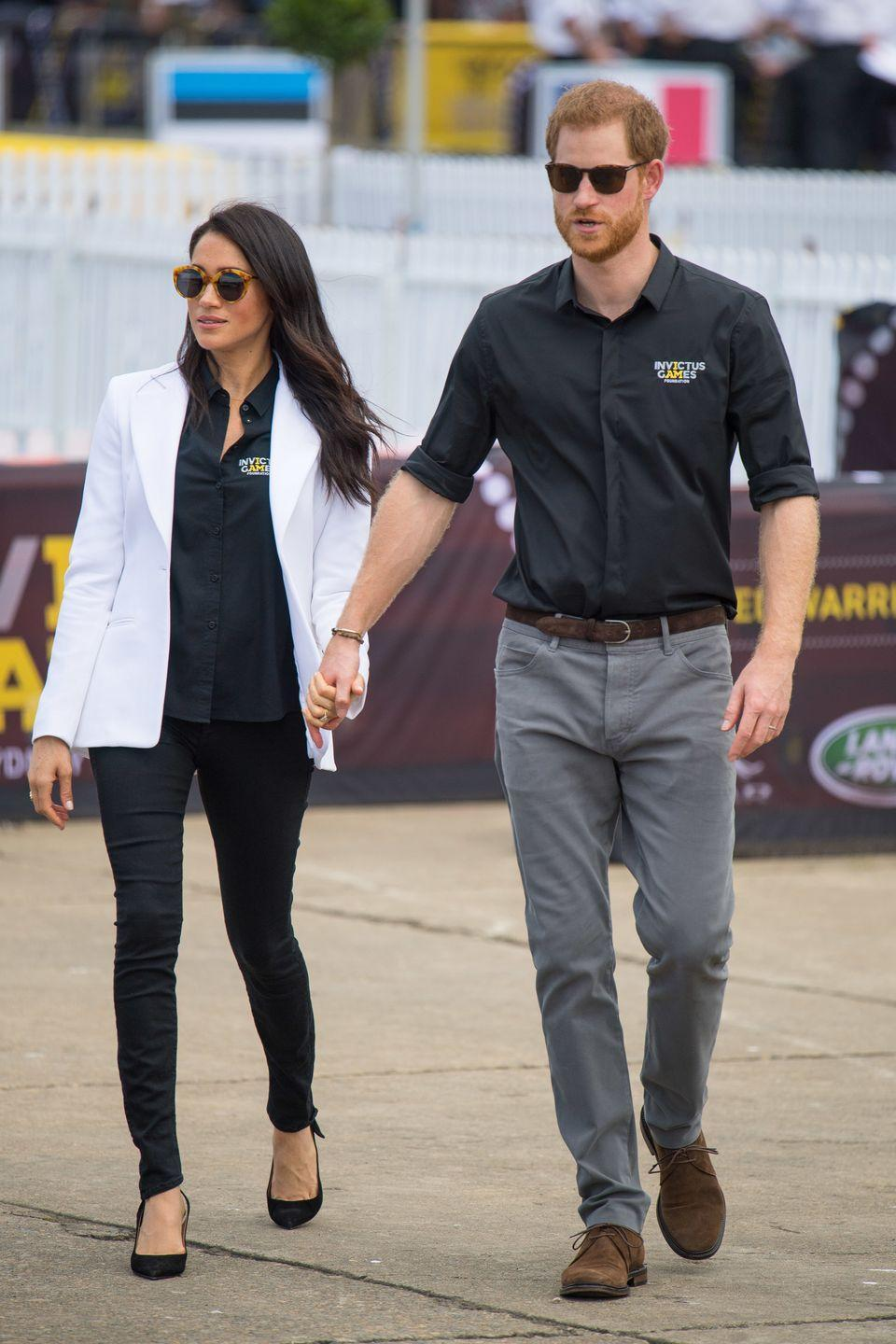"<p>The Duke and Duchess wore matching Invictus Games shirts at the Jaguar Land Rover Driving Challenge. Meghan paired hers with an Altuzarra blazer, skinny jeans by MOTHER Denim, Tabitha Simmons pumps, and a fun pair of sunglasses by Illesteva. </p><p><a class=""link rapid-noclick-resp"" href=""https://go.redirectingat.com?id=74968X1596630&url=https%3A%2F%2Fwww.shopbop.com%2Flooker-skinny-jeans-mother%2Fvp%2Fv%3D1%2F1534840640.htm&sref=https%3A%2F%2Fwww.townandcountrymag.com%2Fstyle%2Ffashion-trends%2Fg3272%2Fmeghan-markle-preppy-style%2F"" rel=""nofollow noopener"" target=""_blank"" data-ylk=""slk:SHOP NOW"">SHOP NOW</a> <em>Skinny Jeans by MOTHER Denim, $196</em></p><p><a class=""link rapid-noclick-resp"" href=""https://go.redirectingat.com?id=74968X1596630&url=https%3A%2F%2Fillesteva.com%2Fproducts%2Fpalm-beach-sunglasses-amber%3Fgclid%3DCj0KCQjw6rXeBRD3ARIsAD9ni9A1dFJxYo0yF6aUIzzgea1fyKLDLe6qcpjO6kWBPbeserXmeunnV3QaApUdEALw_wcB&sref=https%3A%2F%2Fwww.townandcountrymag.com%2Fstyle%2Ffashion-trends%2Fg3272%2Fmeghan-markle-preppy-style%2F"" rel=""nofollow noopener"" target=""_blank"" data-ylk=""slk:SHOP NOW"">SHOP NOW</a> <em>Illesteva Palm Beach Sunglasses, $240</em></p>"