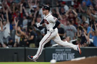 Atlanta Braves' Freddie Freeman rounds the bases after hitting a home run during the sixth inning of the team's baseball game against the Boston Red Sox on Wednesday, June 16, 2021, in Atlanta. (AP Photo/John Bazemore)