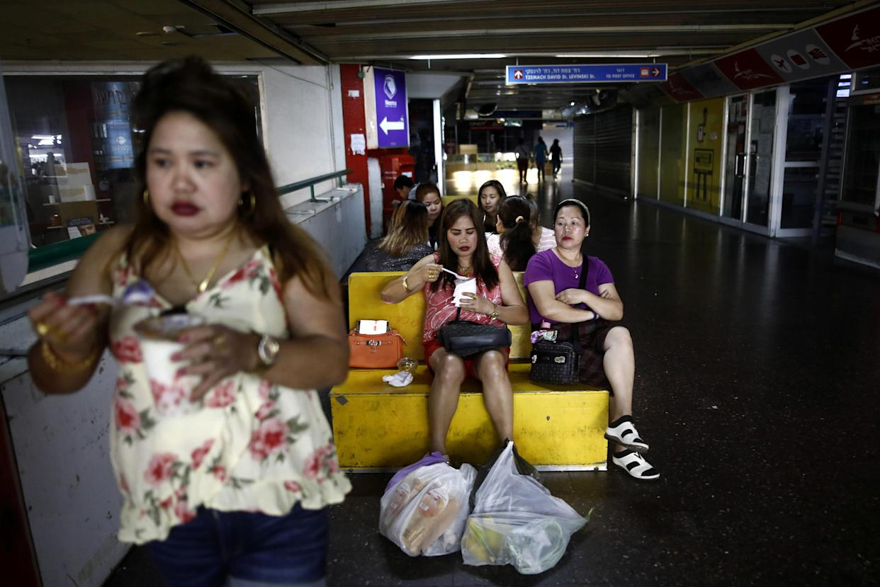 Food purchased from a Filipino food market being consumed inside the Central Bus Station on May 25. (Photo: Corinna Kern/Reuters)