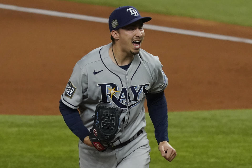 Tampa Bay Rays starting pitcher Blake Snell celebrates after striking out the side during the fourth inning in Game 6 of the baseball World Series Los Angeles Dodgers Tuesday, Oct. 27, 2020, in Arlington, Texas. (AP Photo/Tony Gutierrez)