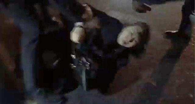 Hong Kong justice secretary Teresa Cheng appearing to be knocked to the ground as she is pursued by protesters in London
