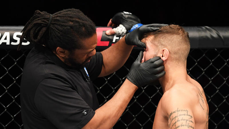 Referee Herb Dean inspects the eye of Jeremy Stephens after an accidental eye poke in his featherweight bout against Yair Rodriguez of Mexico during the UFC Fight Night event on September 21, 2019 in Mexico City, Mexico. (Photo by Josh Hedges/Zuffa LLC/Zuffa LLC via Getty Images)