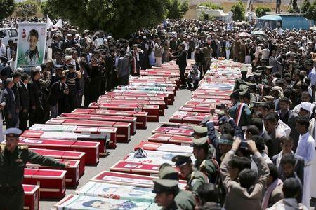People gather around the coffins of victims of suicide attacks during a mass funeral procession in Sanaa March 25, 2015. REUTERS/Khaled Abdullah
