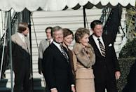 <p>President Carter and First Lady Rosalynn Carter greet President-elect Ronald Reagan and his wife, Nancy, at the diplomatic entrance of the White House on November 20, 1980.</p>