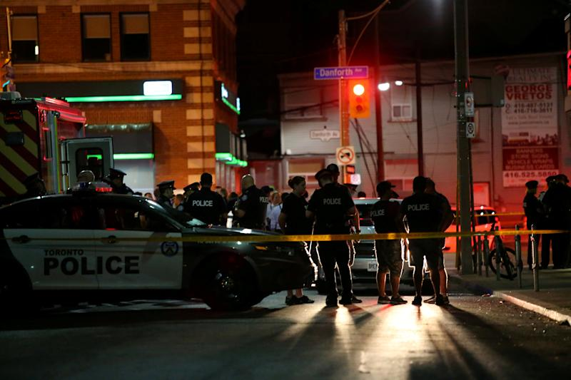 Police are seen near the scene of a mass shooting in Toronto
