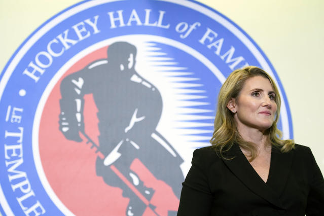 "FILE - In this Nov. 15, 2019, file photo, Hockey Hall of Fame inductee Hayley Wickenheiser poses in Toronto. Regional Olympic officials are rallying around the IOC and have backed its stance on opening the Tokyo Games as scheduled. Their support comes one day after direct criticism from athletes amid the coronavirus outbreak. ""I think the IOC insisting this will move ahead, with such conviction, is insensitive and irresponsible given the state of humanity,"" said Wickenheiser, a four-time Olympic hockey gold medalist from Canada. (Nathan Denette/The Canadian Press via AP, Fle)"