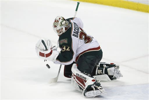 Minnesota Wild goalie Niklas Backstrom (32) stops the puck during the second period of an NHL hockey game against the Florida Panthers, Thursday, Feb. 23, 2012, in Sunrise, Fla. (AP Photo/Lynne Sladky)