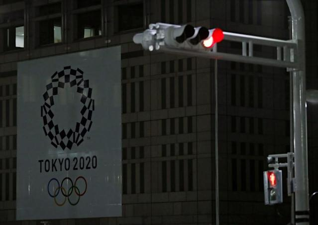 Banner for the upcoming Tokyo 2020 Olympics is seen behind traffic lights in Tokyo