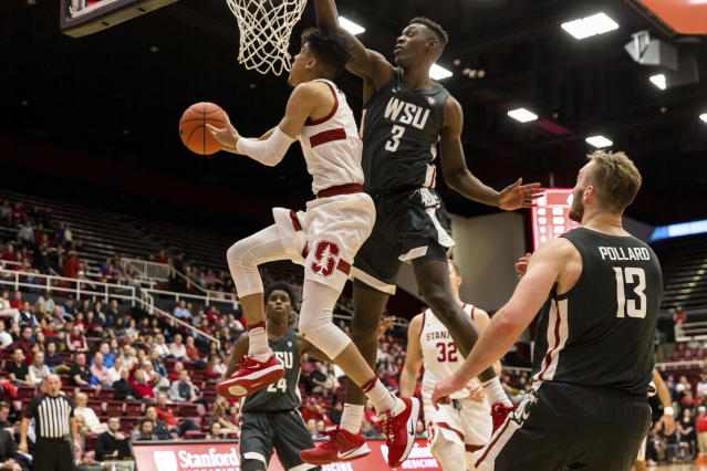 Stanford guard Tyrell Terry, left, shoots as Washington State forward Daron Henson (3) defends during the first half of an NCAA college basketball game Saturday, Jan. 11, 2020, in Stanford, Calif. (AP Photo/John Hefti)