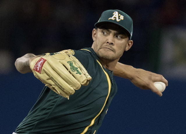Oakland Athletics starting pitcher Sean Manaea throws against the Toronto Blue Jays during the first inning of a baseball game in Toronto, Saturday, May 19, 2018. (Fred Thornhill/The Canadian Press via AP)