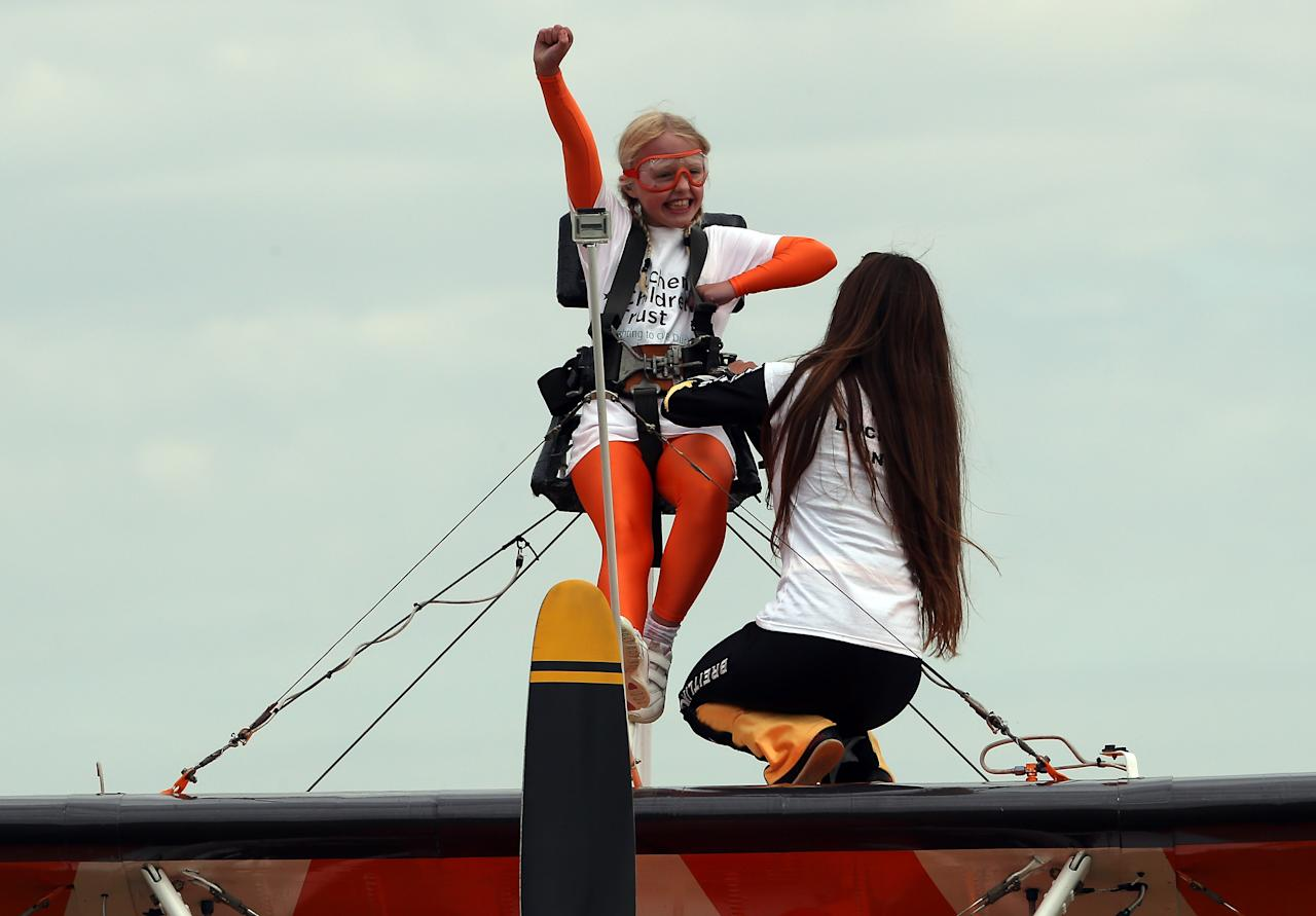 Nine-year-old Rose Powell prepares to go wing-walking over Rendcomb Airfield near Cirencester for the charity Duchenne Children's Trust.